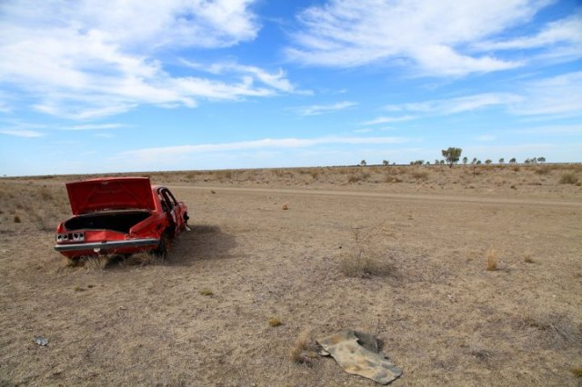 One of many abandoned cars sits on the side of a dirt highway deep inside the Murrawarri nation, in the 16,000-hectare property of Murrawarri People's Council leader Fred Hooper, a.k.a. King Fred SOURCE: TIME